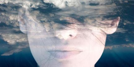 Dream like surreal double exposure portrait of attractive lady combined with aerial view photograph